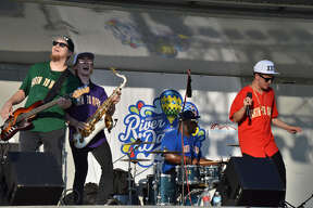 "Earth to Mars, a Bruno Mars tribute band, rocked the 7-9 p.m. set at the Riverdays Festival on Aug. 2, 2019 in downtown Midland. Their covers of popular songs like ""Just the Way You Are"" and ""Treasure"" had a few young members of the audience dancing front and center. (Ashley Schafer/Ashley.Schafer@hearstnp.com)"