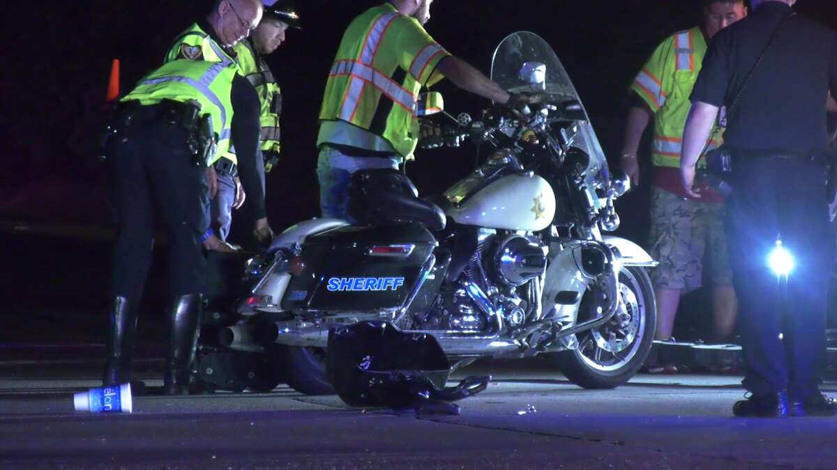 Two motorcycle officers were injured by a suspected drunk driver while escorting two giant crates through Houston Friday night.