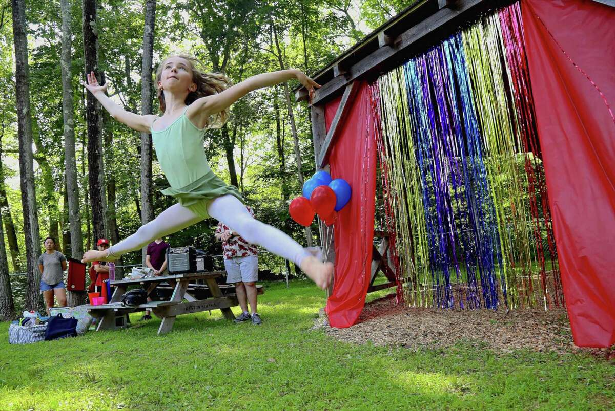 Dancer Sabrina Wiese, 11, of Weston, takes to the air at the Weston's Next Big Thing talent show at Bisceglie-Scribner Pond on Thursday, Aug. 1, 2019, in Weston, Conn.
