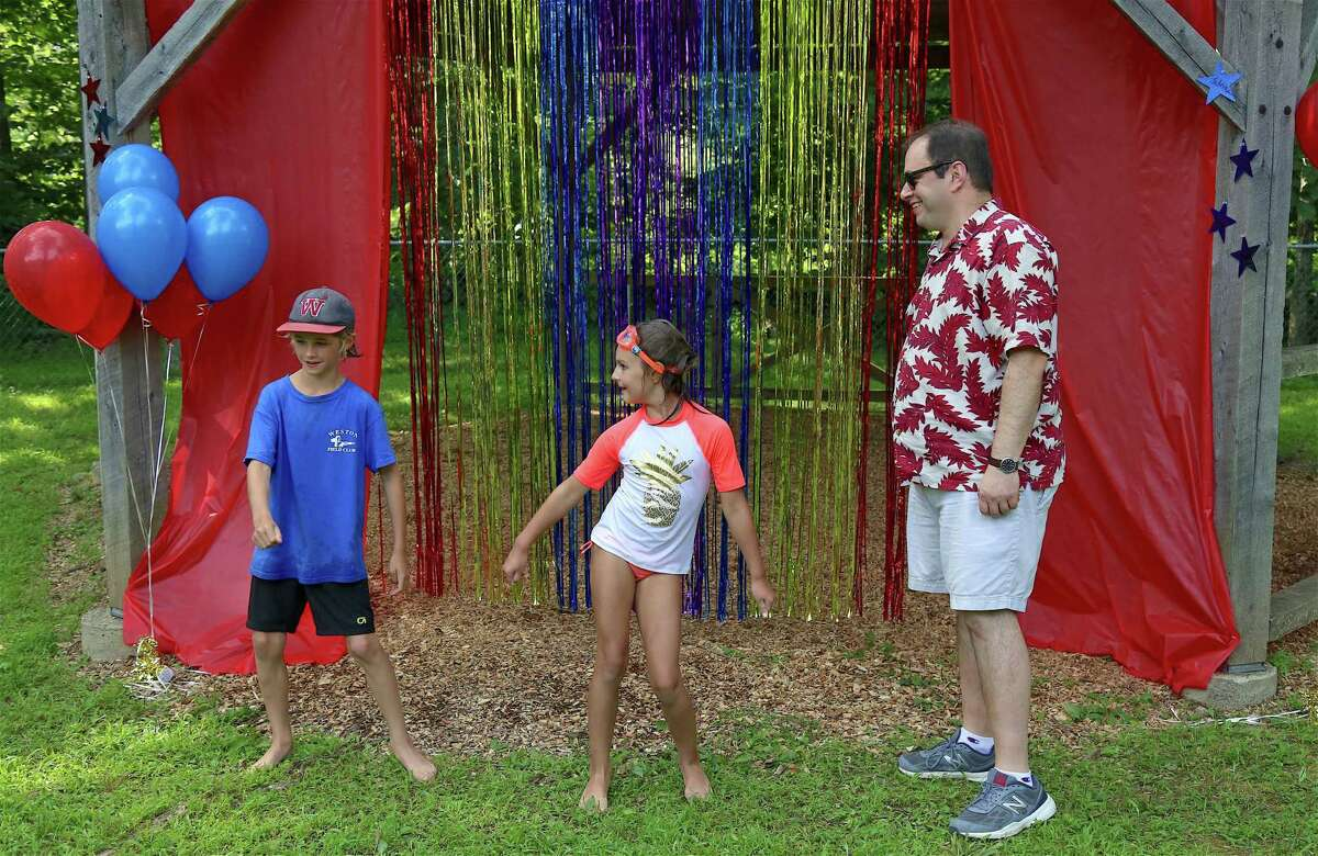 Dance-off winners Ricky Wiese, 9, and Angelika Soennichsen, 7, both of Weston, show their moves for host Jason Revcon at the Weston's Next Big Thing talent show at Bisceglie-Scribner Pond on Thursday, Aug. 1, 2019, in Weston, Conn.