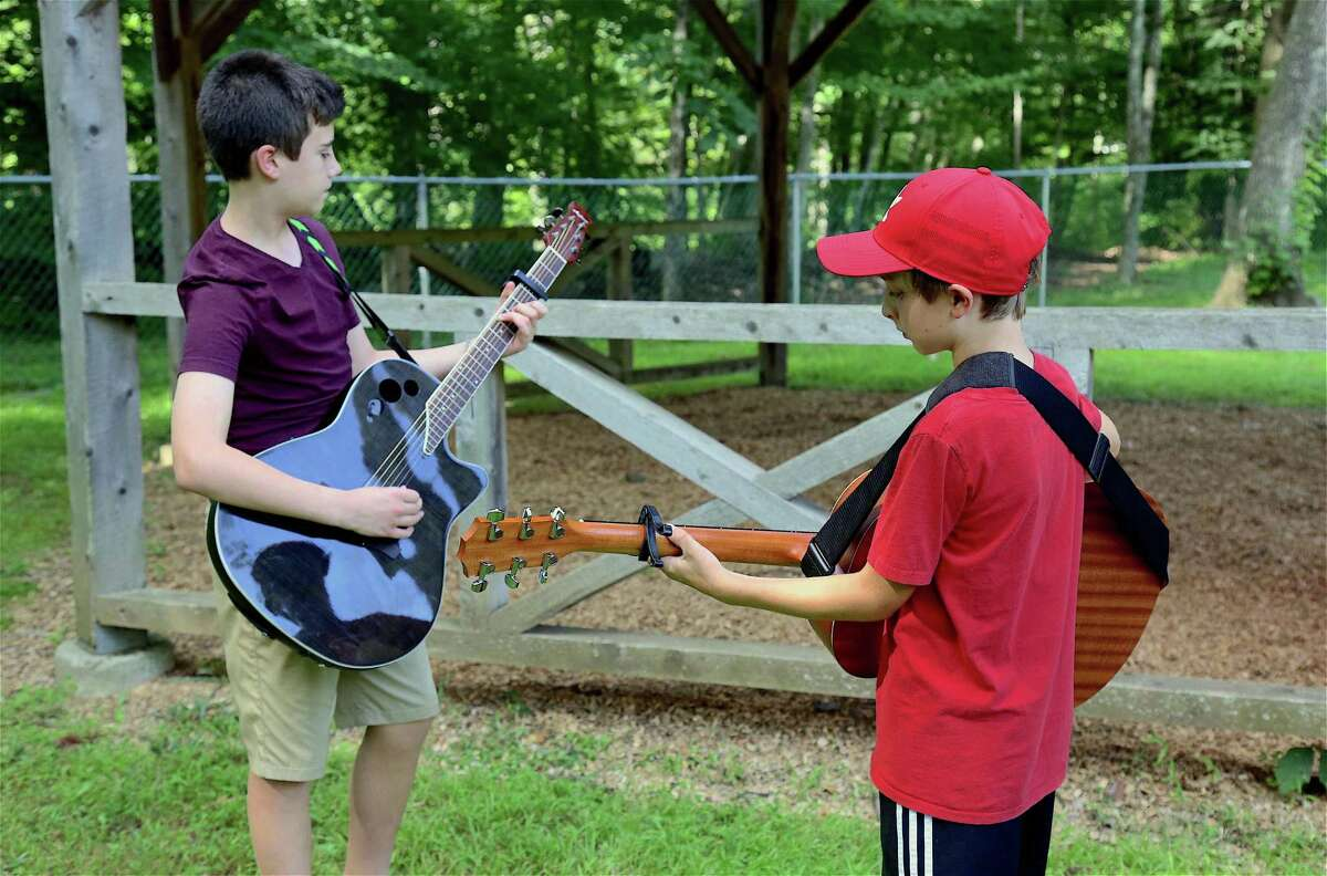 Practicing their prize-winning number are Owen Bernheim, 11, left, and Harris Schulz, 11, of Weston at the Weston's Next Big Thing talent show at Bisceglie-Scribner Pond on Thursday, Aug. 1, 2019, in Weston, Conn.