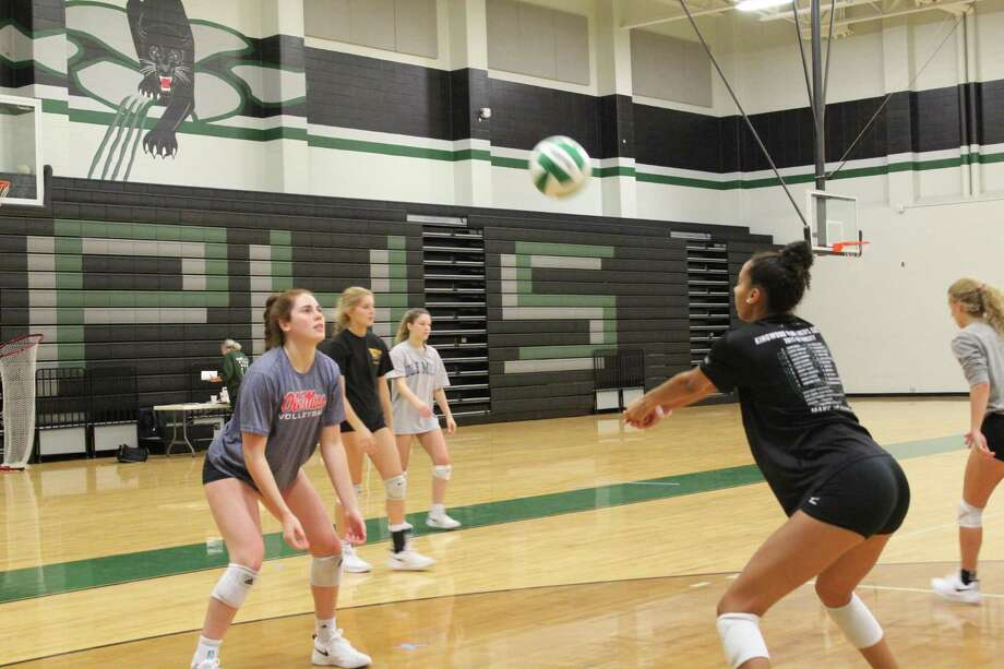 Kingwood Park's Libby Overmyer (left) and Alia Williams warmup on the first day of practice at the Panthers Gym. Photo: Marcus Gutierrez Staff Photo