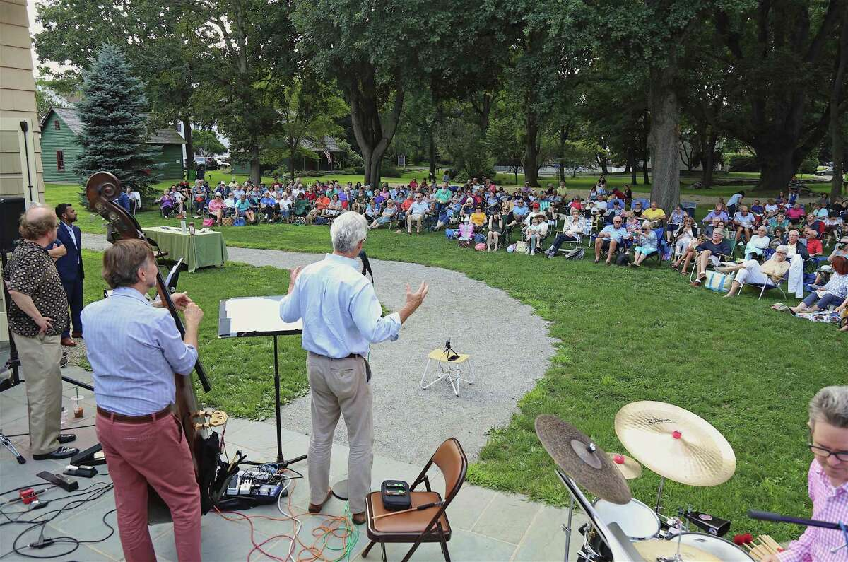 Michael Jehle, executive director, introduces the band at the opening night of Jazz Fridays at the Fairfield Museum and History Center on Aug. 2, 2019, in Fairfield, Conn.