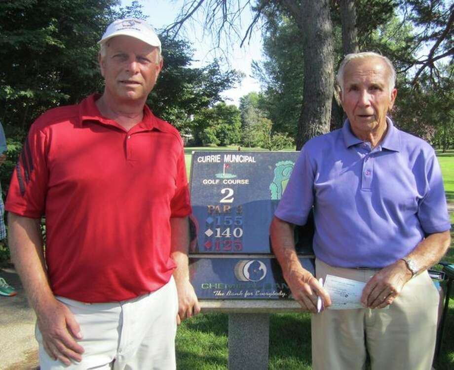 Larry Snyder, right,took first place and third place, and Marc Derrick, left, took second place in the annual Lions Club Charities Shoot for Sight Hole-in-One Contest that concluded Friday at Currie Golf Course. Snyder also won the contest in 2007. (Photo provided)