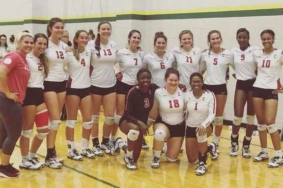 The Crosby Lady Cougar volleyball team is all smiles after beating Port Neches-Groves on August 11, 2018