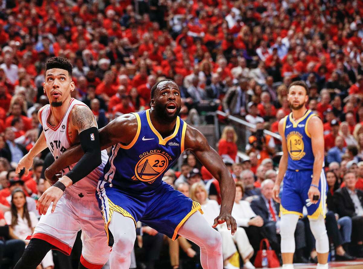 Golden State Warriors' Draymond Green boxes out Toronto Raptors' Danny Green in the third quarter during game 5 of the NBA Finals between the Golden State Warriors and the Toronto Raptors at Scotiabank Arena on Monday, June 10, 2019 in Toronto, Ontario, Canada.