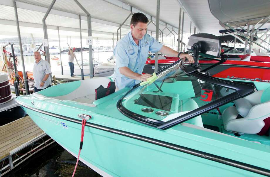 Nautical Boat Club co-owner Nik Van Zandan washes one of the organization's eight boats on Lake Conroe, Thursday, Aug. 1, 2019, in Montgomery. The club, which offers members unlimited boating for a fee rather than owning a boat, is a first for the Greater Houston area. Photo: Jason Fochtman, Houston Chronicle / Staff Photographer / Houston Chronicle