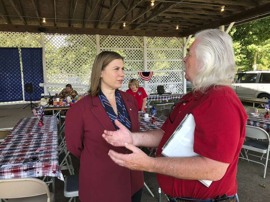 Rep. Elissa Slotkin, D-Mich., talks with a constituent Friday at a county fair in Mason. Photo: David Eggert / Associated Press