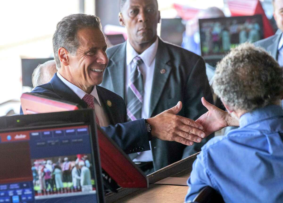Governor Andrew Cuomo greets racing patrons in the box area of the Saratoga Race Course during a brief visit to the track Saturday, Aug. 3, 2019 in Saratoga Springs, N.Y. Photo Special to the Times Union by Skip Dickstein