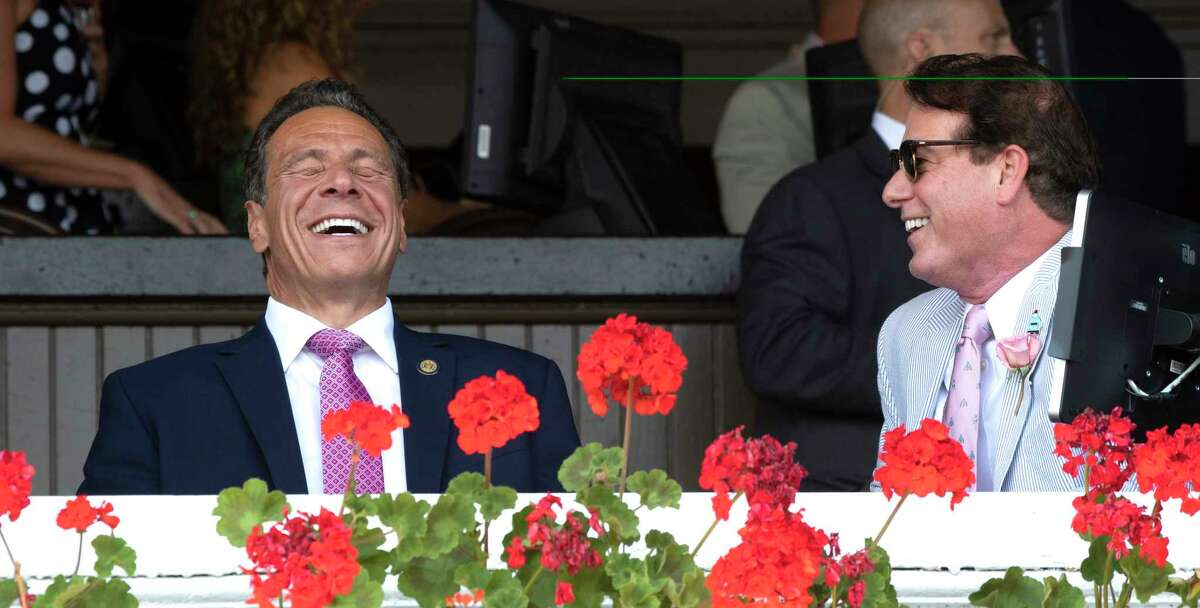 Governor Andrew Cuomo, left shares a laugh with John Hendrickison during a brief visit to the Saratoga Race Course Saturday, Aug. 3, 2019 in Saratoga Springs, N.Y. Photo Special to the Times Union by Skip Dickstein