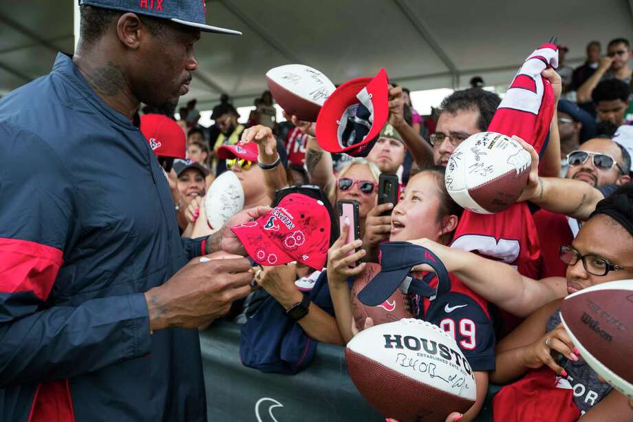 PHOTOS: The rest of the Class of 2019 Gridiron Legends Andre Johnson, former Houston Texans wide receiver and special assistant to the head coach, signs autographs during training camp at the Methodist Training Center on Saturday, Aug. 3, 2019, in Houston. Photo: Brett Coomer, Staff Photographer / © 2019 Houston Chronicle