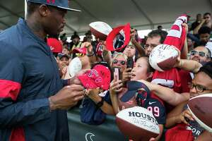 Andre Johnson, former Houston Texans wide receiver and special assistant to the head coach, signs autographs during training camp at the Methodist Training Center on Saturday, Aug. 3, 2019, in Houston.