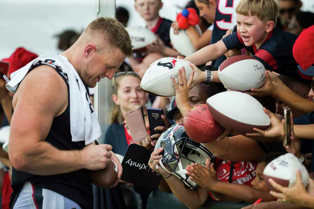Houston Texans defensive end J.J. Watt signs autographs during training camp at the Methodist Training Center on Saturday, Aug. 3, 2019, in Houston.