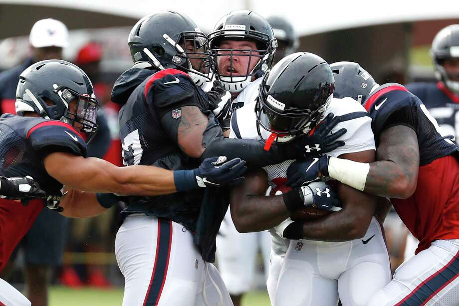 PHOTOS: Texans preseason vs. Lions  Houston Texans running back Lamar Miller gets caught by defensive end Angelo Blackson (97) as he runs the ball through the line during training camp at the Methodist Training Center on Saturday, Aug. 3, 2019, in Houston.  >>>Look back at photos from the Texans' first preseason win of the season ...  Photo: Brett Coomer, Staff Photographer / © 2019 Houston Chronicle