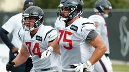 Houston Texans offensive tackles Max Scharping (74) and Matt Kalil (75) run down the field after breaking off the line during training camp at the Methodist Training Center on Saturday, Aug. 3, 2019, in Houston.