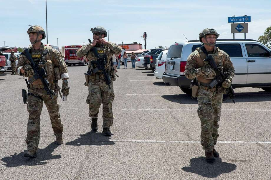 """Law enforcement agencies respond to an active shooter at a Wal-Mart near Cielo Vista Mall in El Paso, Texas, Saturday, Aug. 3, 2019. - Police said there may be more than one suspect involved in an active shooter situation Saturday in El Paso, Texas. City police said on Twitter they had received """"multi reports of multipe shooters."""" There was no immediate word on casualties. (Photo by Joel Angel JUAREZ / AFP)        (Photo credit should read JOEL ANGEL JUAREZ/AFP/Getty Images) Photo: JOEL ANGEL JUAREZ/AFP/Getty Images"""