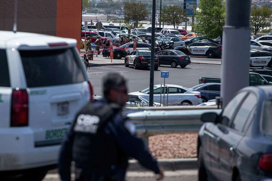"""Law enforcement agencies respond to an active shooter at a Wal-Mart near Cielo Vista Mall in El Paso, Texas, Saturday, Aug. 3, 2019. - Police said there may be more than one suspect involved in an active shooter situation Saturday in El Paso, Texas. City police said on Twitter they had received """"multi reports of multipe shooters."""" There was no immediate word on casualties. (Photo by Joel Angel Juarez / AFP)JOEL ANGEL JUAREZ/AFP/Getty Images Photo: JOEL ANGEL JUAREZ, AFP/Getty Images / AFP or licensors"""
