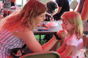 Anna Knopp, 5, gets her face painted at the Riverdays Festival on Aug. 3, 2019 in downtown Midland. (Mitchell Kukulka/Mitchell.Kukulka@mdn.net)