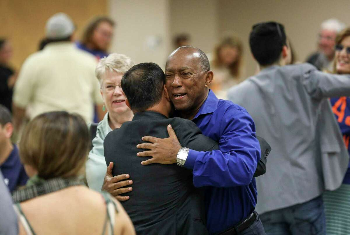 Houston Mayor Sylvester Turner greets Nelvin Adriatico, a candidate for Houston City Council District J, before a Houston GLBT Political Caucus meeting on Saturday, Aug. 3, 2019, in Houston.