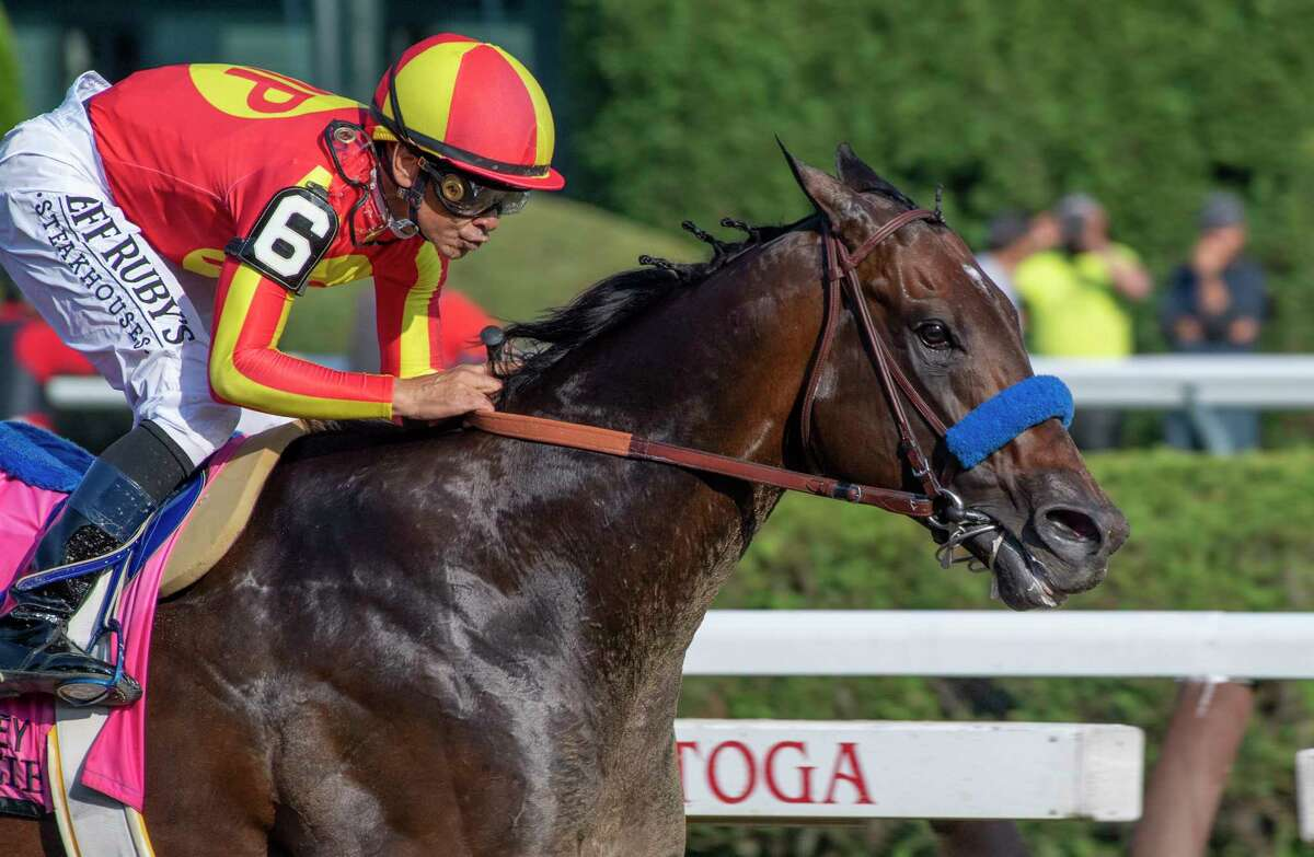 McKinzie with jockey Mike Smith on the way to the win in the 92nd running of The Whitney at the Saratoga Race Course Saturday, Aug. 3, 2019 in Saratoga Springs, N.Y. Photo Special to the Times Union by Skip Dickstein