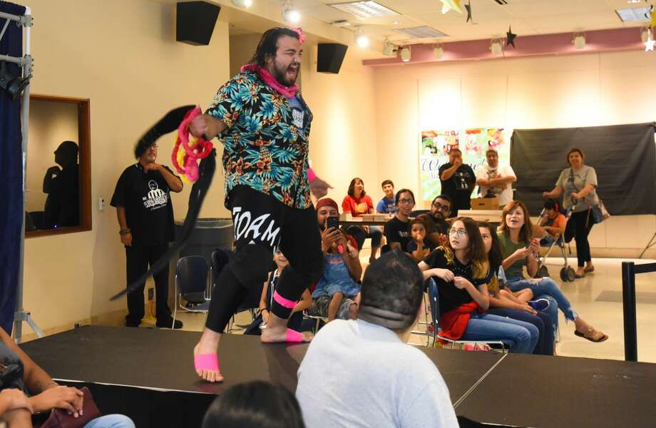 Wrestling fans watch some of their favorite wrestlers during Five Star Wrestling's Lucha at the Library, Saturday, Aug. 3, 2019, at the Joe A. Guerra Laredo Public Library. Photo: Danny Zaragoza
