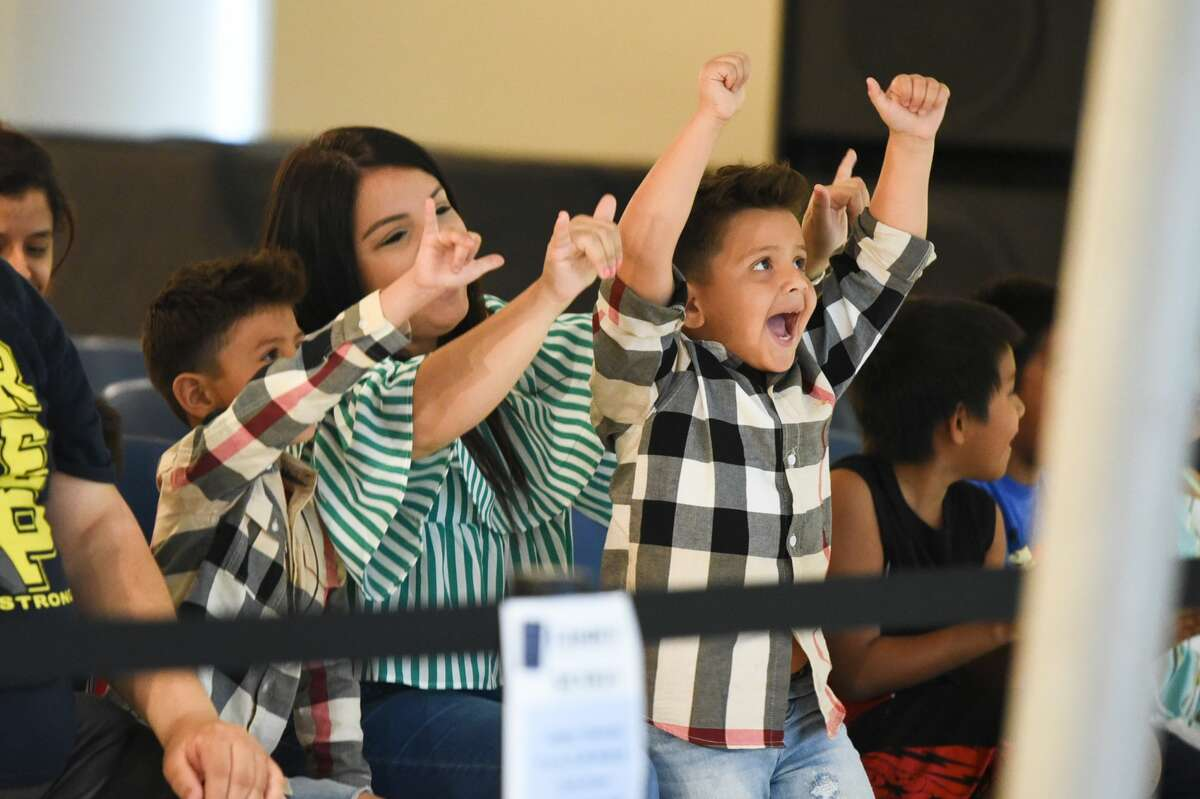 Wrestling fans watch some of their favorite wrestlers during Five Star Wrestling's Lucha at the Library, Saturday, Aug. 3, 2019, at the Joe A. Guerra Laredo Public Library.