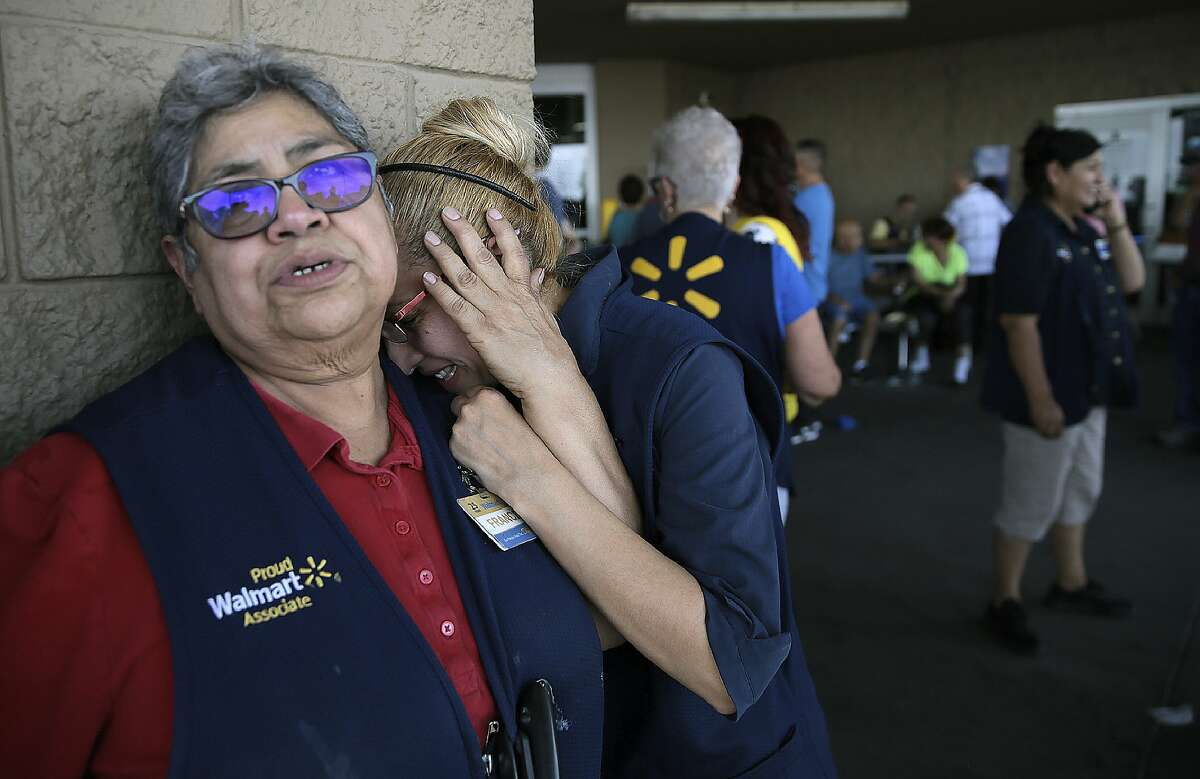 Walmart employees react after an active shooter opened fire at the store in El Paso, Texas, Saturday, Aug. 3, 2019.