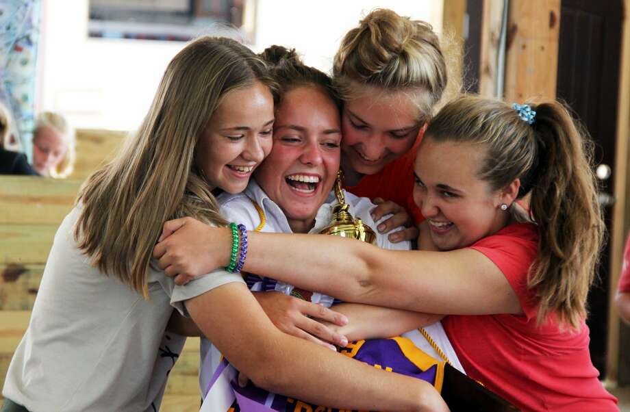 Maddie Lasaowski, second from the left, celebrates after winning the JLA Sweepstakes at the Huron community fair. Photo: Andrew Mullin/Huron Daily Tribune