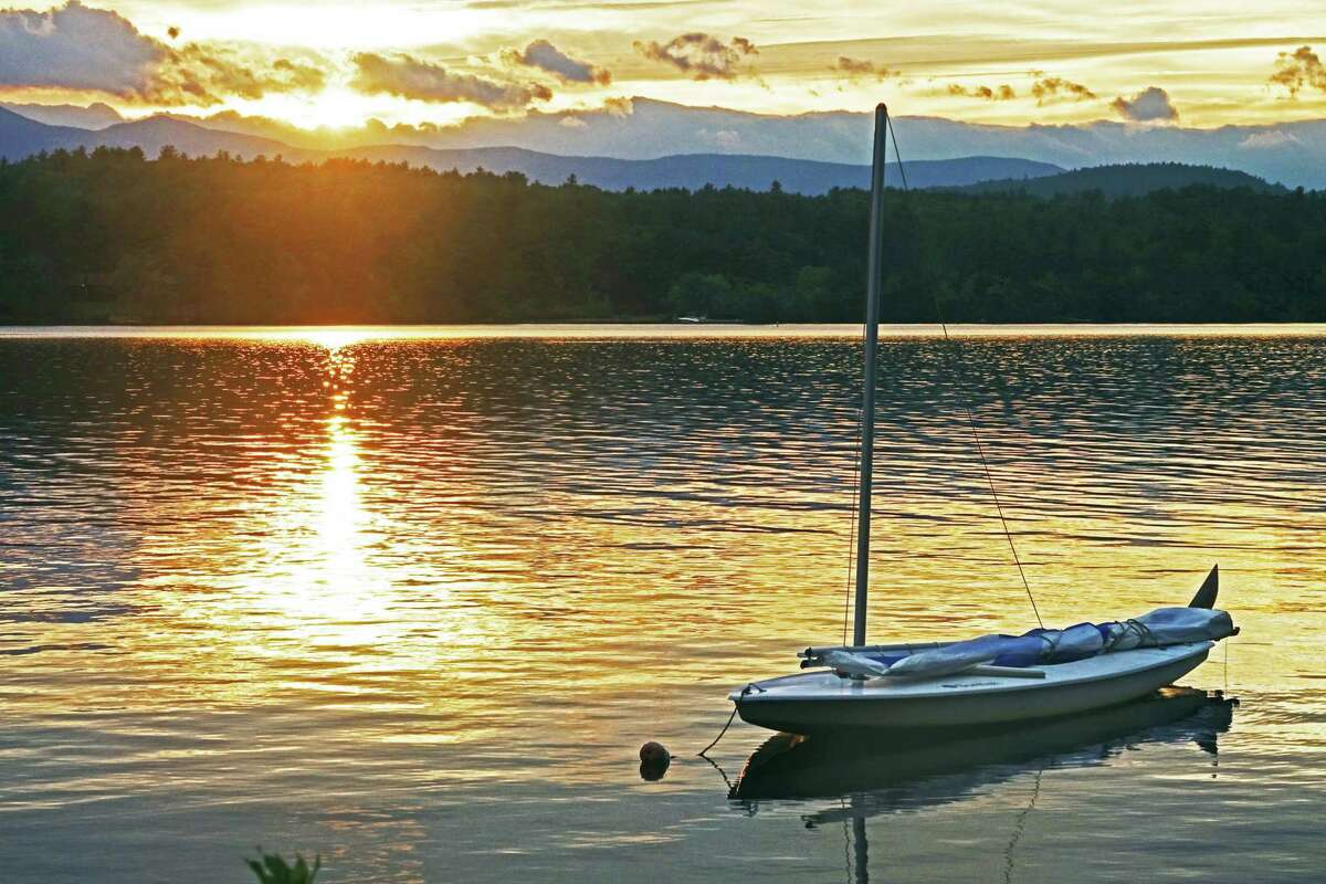 Saratoga Springs resident Roger Goodman's photo is of a sunset at Lake Kezar in Lovell, Maine, taken at Quisisana Resort. Resort staff are either students or professionals in musical theater or opera. The person serving you food or helping you into a kayak during the day might be singing an aria or playing in a musical that night, Goodman says.