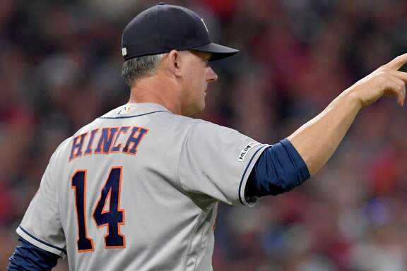 CLEVELAND, OHIO - JULY 31: Manager AJ Hinch #14 of the Houston Astros signals for a pitching change in the fifth inning against the Cleveland Indians at Progressive Field on July 31, 2019 in Cleveland, Ohio. (Photo by Jason Miller/Getty Images)