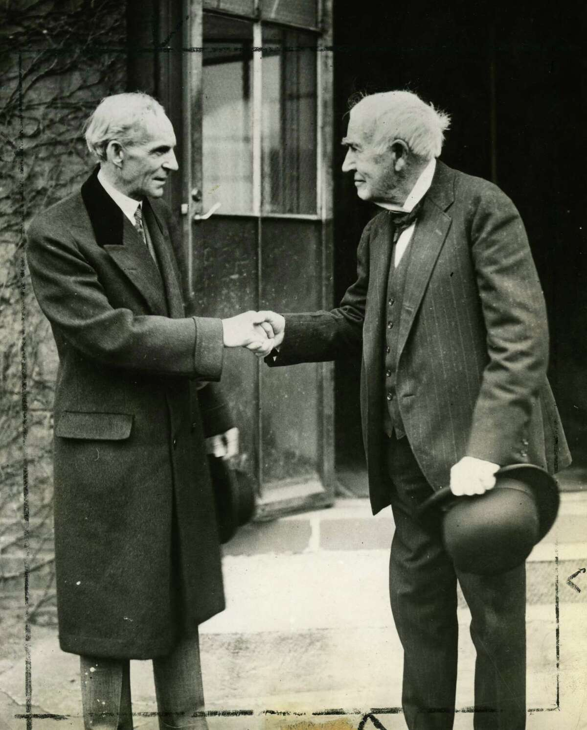 Thomas Edison, right, and Henry Ford shake hands, ca. 1920s. (Wide World Photo/Times Union archive print)