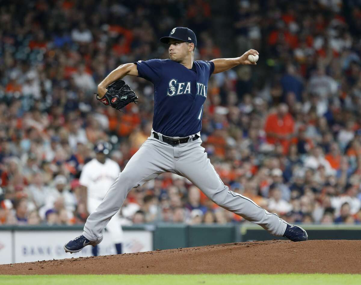 Seattle Mariners starting pitcher Marco Gonzales (7) pitches during the first innning of an MLB game at Minute Maid Park, Sunday, August 3, 2019.