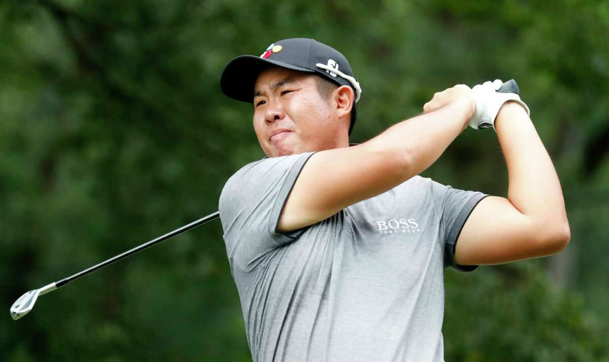 Byeong Hun An watches his tee shot on the fourth hole hole during the third round of the Wyndham Championship golf tournament at Sedgefield Country Club in Greensboro, N.C. Saturday, August 3, 2019. (AP Photo/Chris Seward)