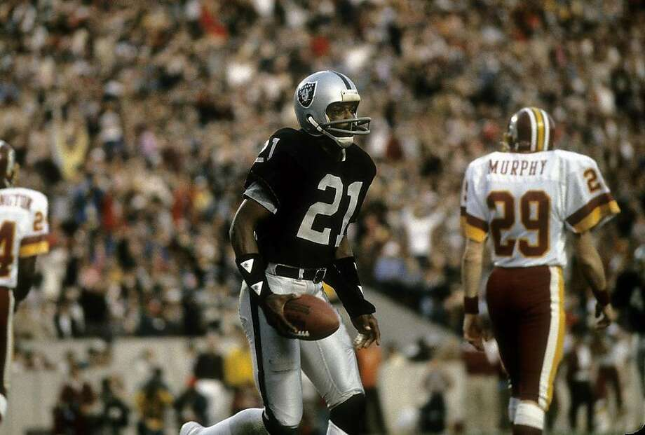 TAMPA, FL - JANUARY 22, 1984: Wide receiver Cliff Branch #21 of the Los Angeles Raiders plays during Super Bowl XVIII against the Washington Redskins on January 22, 1984 at Tampa Stadium in Tampa, Florida. The Raiders won the Super Bowl 38 - 9. (Photo by Focus on Sport/Getty Images) Photo: Focus On Sport, Getty Images