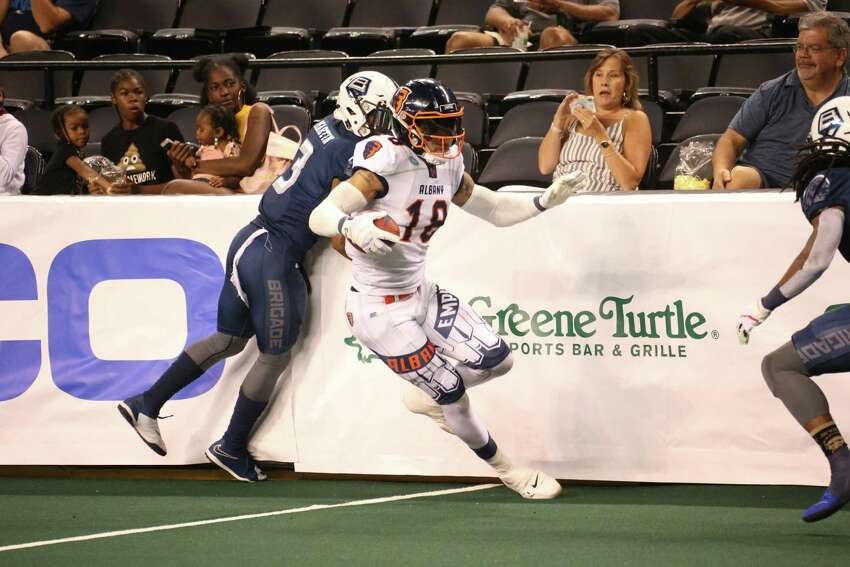 Albany's Quentin Sims makes a move on a short completion from quarterback Tommy Grady in Albany's 62-21 win in the second game of their aggregate score playoff series in Baltimore on Saturday, Aug. 3, 2019. (Ned Dishman / Arena Football League)