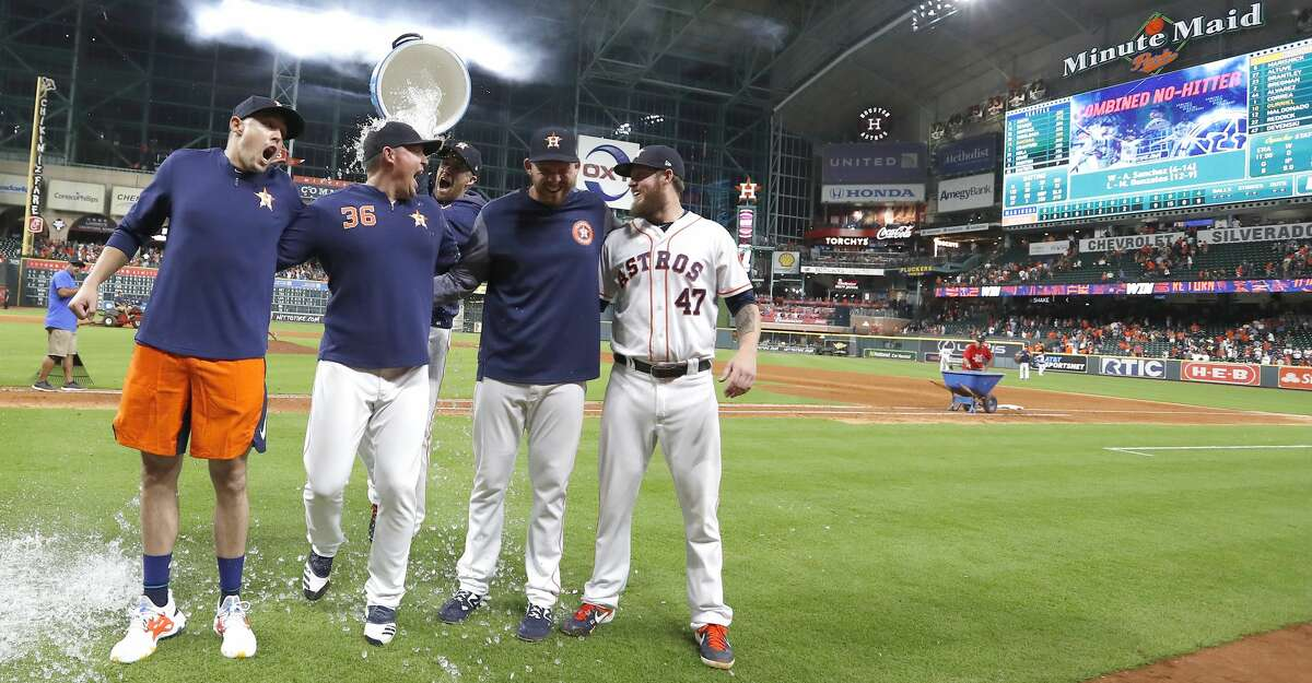 PHOTOS: More from the Astros' 12th no-hitter Houston Astros pitcher Collin McHugh sneaks up with a bucket of ice water to dump on starting pitcher Aaron Sanchez, left, and relief pitchers Will Harris (36), Joe Biagini (29) and Chris Devenski (47) pose after an MLB game at Minute Maid Park, Sunday, August 3, 2019. The Astros pitchers combined for a four-pitcher, no-hitter against the Seattle Mariners, and won the game 9-0.