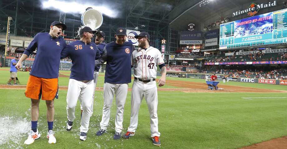 PHOTOS: More from the Astros' 12th no-hitter Houston Astros pitcher Collin McHugh sneaks up with a bucket of ice water to dump on starting pitcher Aaron Sanchez, left, and relief pitchers Will Harris (36), Joe Biagini (29) and Chris Devenski (47) pose after an MLB game at Minute Maid Park, Sunday, August 3, 2019.  The Astros pitchers combined for a four-pitcher, no-hitter against the Seattle Mariners, and won the game 9-0. Photo: Karen Warren/Staff Photographer