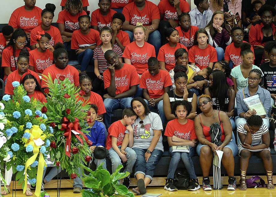 Members of the community, including a bleacher section filled with school mates, and family gather in the gymnasium at Jasper Junior High School for Nicholas Trevon McBride's funeral services Saturday. The 12-year-old was accidentally shot and killed last weekend.  