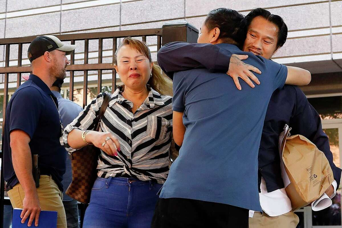 In this Wednesday, June 12, 2019 photo, Ammala Mingsouan embraces family outside the building that houses Immigration and Customs Enforcement and the Atlanta Immigration Court after being released from ICE custody, in Atlanta. Mingsouan's mother Littun Saenbouttaiath, right, said she had not seen him for 24 years. (AP Photo/Andrea Smith)
