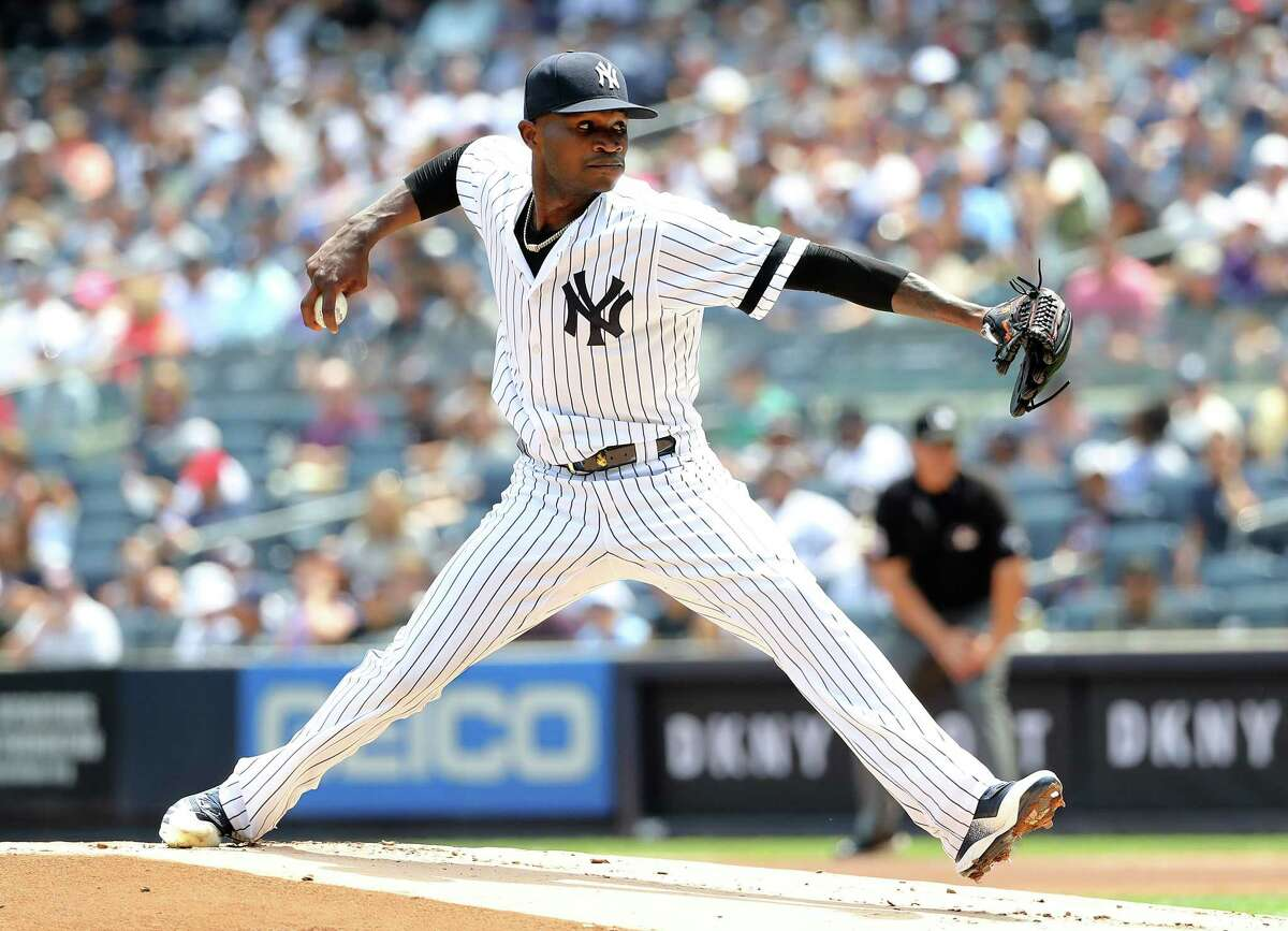 NEW YORK, NEW YORK - AUGUST 03: Domingo German #55 of the New York Yankees delivers a pitch in the first inning against the Boston Red Sox during game one of a double header at Yankee Stadium on August 03, 2019 in the Bronx borough of New York City. (Photo by Elsa/Getty Images)