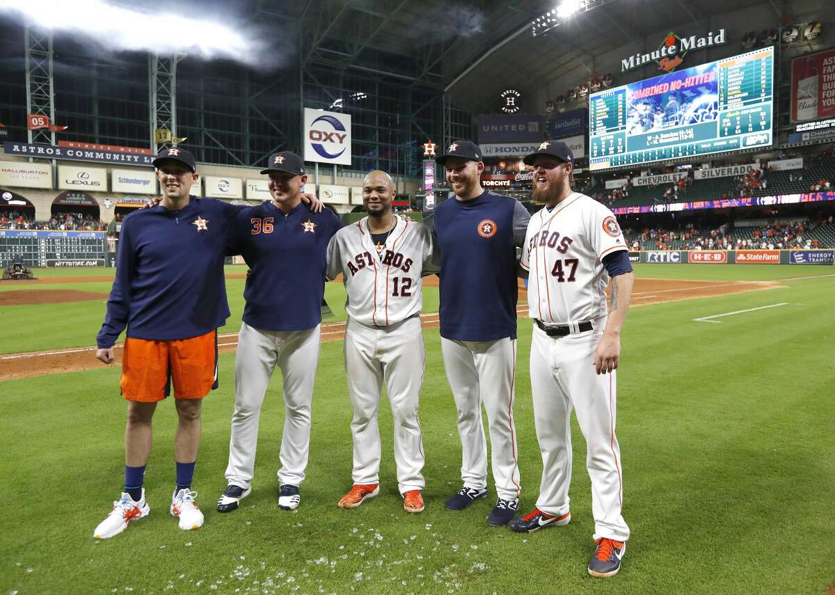 Houston Astros starting pitcher Aaron Sanchez, left, and relief pitchers Will Harris (36), catcher Martin Maldonado, center, and Joe Biagini (29 and Chris Devenski (47) pose after an MLB game at Minute Maid Park, Sunday, August 3, 2019. The Astros pitchers combined for a four-pitcher, no-hitter against the Seattle Mariners, and won the game 9-0.