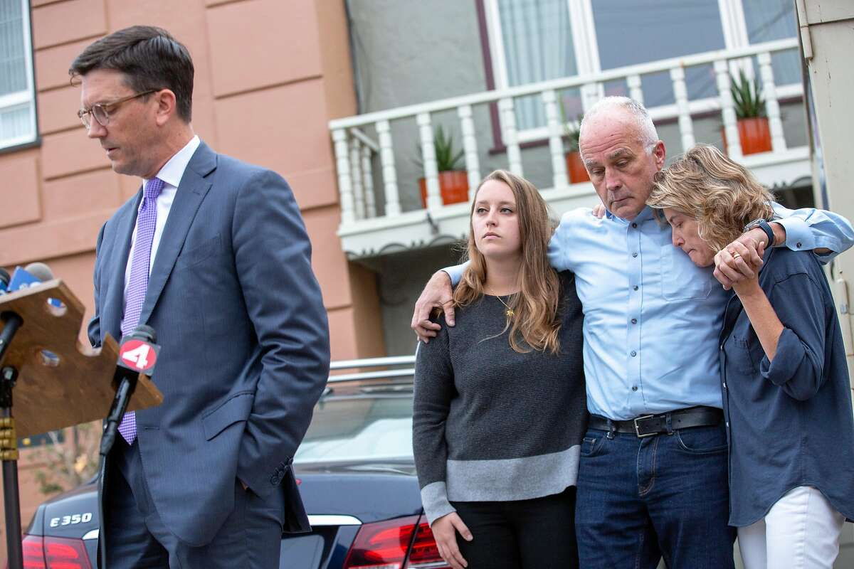 Family attorney Craig Peters (left) makes a statement to members of the news media on behalf of Ethan Elder (second from right) and his family outside their home on Saturday, Aug. 3, 2019, in San Francisco, Calif. Elder is the father of Finnegan Elder, 19, who is accused in the stabbing death of 35-year-old Carabinieri police officer Mario Cerciello Rega in Italy. Ethan recently returned to S.F. after visiting his jailed son in Italy.