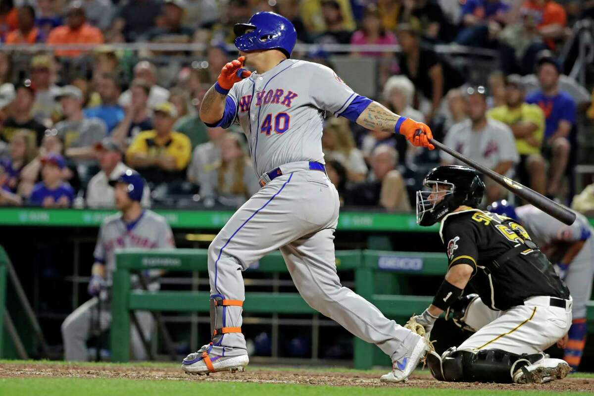 New York Mets' Wilson Ramos follows through on a two-run home run off Pittsburgh Pirates relief pitcher Kyle Crick during the eighth inning of a baseball game in Pittsburgh, Saturday, Aug. 3, 2019. (AP Photo/Gene J. Puskar)