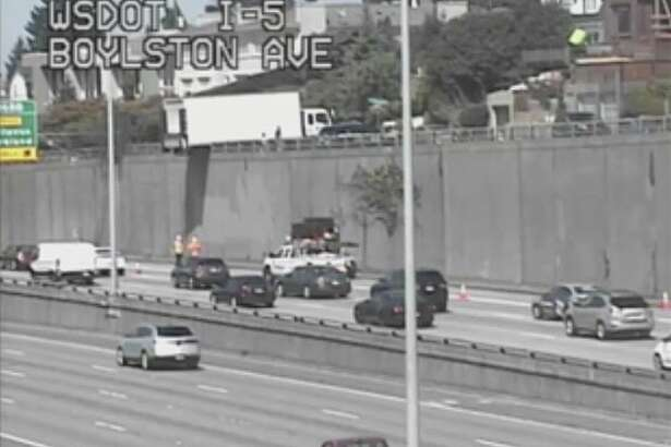 Large truck ends up partially dangling over I-5 in Seattle (WSDOT Photo)
