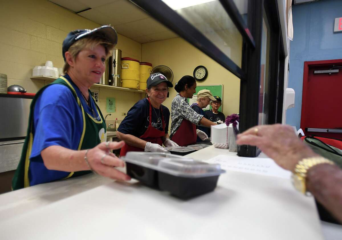 Donna Forgas, left, helps package food for Meals on Wheels at Some Other Place Monday. Photo taken Monday, 7/29/19