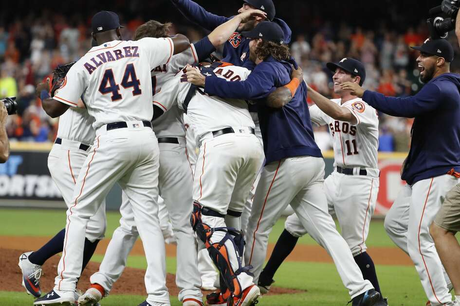 Houston Astros players mob Houston Astros relief pitcher Chris Devenski (47) after he finished off the Seattle Mariners to complete a combined no-hitter at Minute Maid Park on Saturday, Aug. 3, 2019, in Houston. Astros pitchers Aaron Sanchez, Will Harris, Joe Biagini and Chris Devenski pulled off the no-hitter.