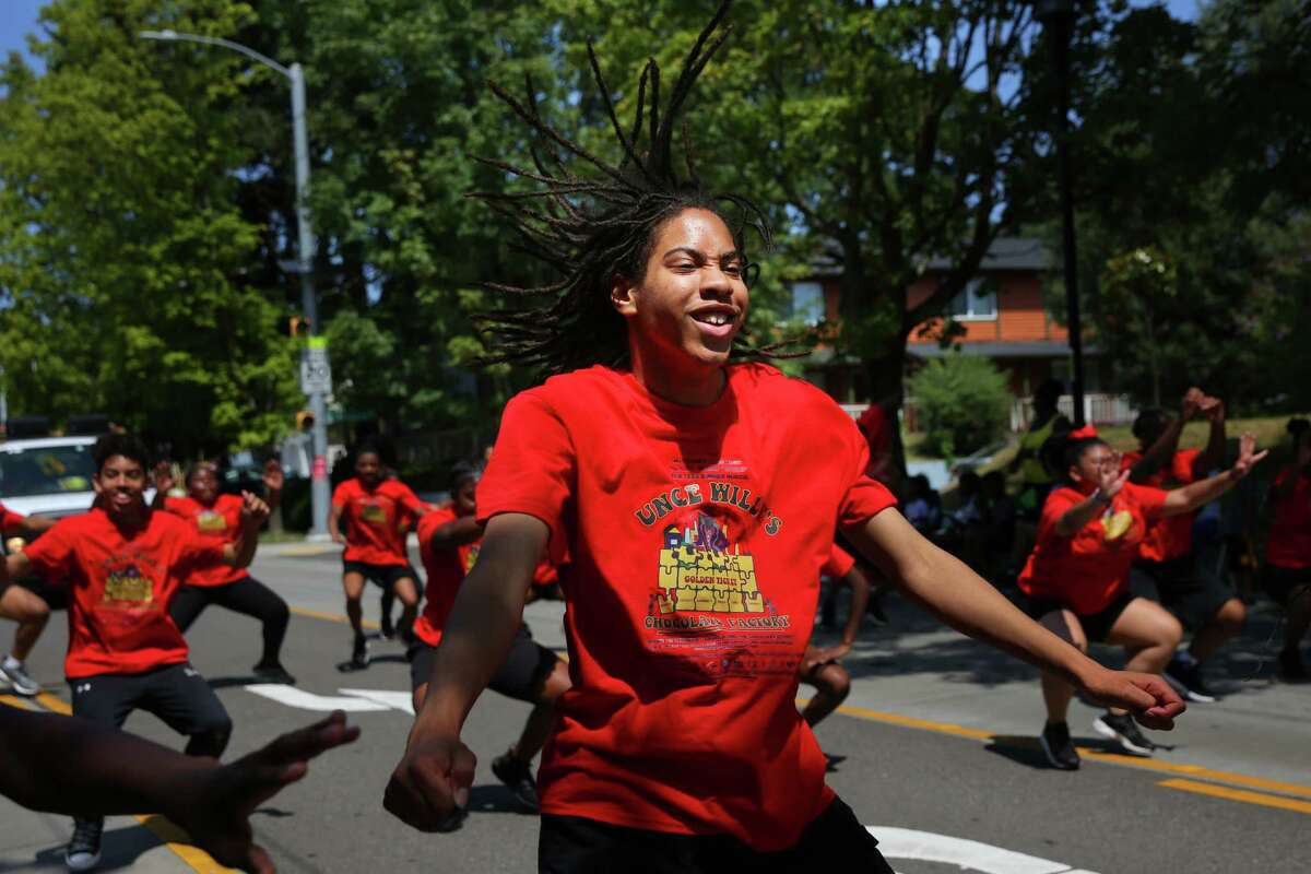 Uncle Willy's Chocolate Festival cast member Isaiah Banks, 14, dances during the Umoja Fest AfricaTown Heritage Parade along E 23rd Avenue, Saturday, Aug. 3, 2019.