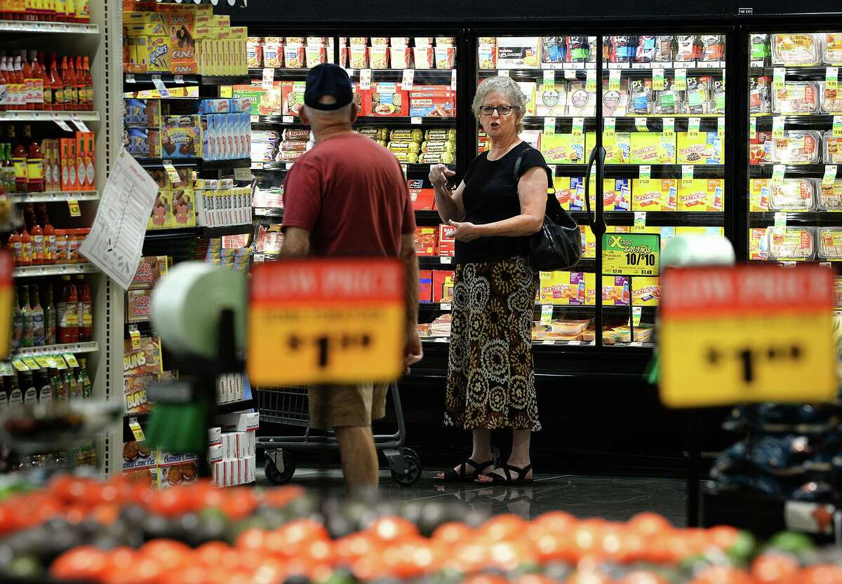 Rhonda Ogea talks to Charles Ogea while shopping at Mauriceville's newly opened Market Basket on Wednesday. Photo taken Wednesday, 7/31/19