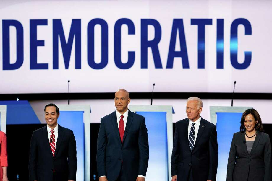 Julián Castro, Sen. Cory Booker, Joe Biden and Sen. Kamala Harris at the start of the second night of the Democratic presidential debates in Detroit on July 31, 2019. President Donald Trump's allies and Republican strategists said they had received largely what they wanted from the two nights of debates: five hours of Democrats  questioning the practicality of liberal wish-list items. (Erin Schaff/The New York Times) Photo: ERIN SCHAFF, STF / NYT / NYTNS