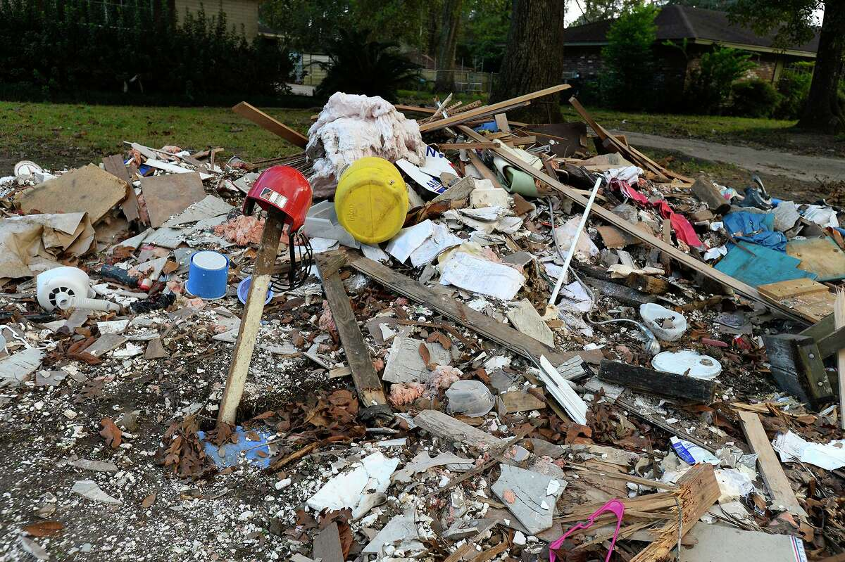 Remnants from piles of debris remain outside of homes in Wexford Park near Vidor on Thursday afternoon. Photo taken Thursday 11/2/17 Ryan Pelham/The Enterprise